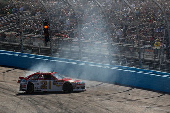 AVONDALE, AZ - FEBRUARY 27:  Trevor Bayne, driver of the #21 Motorcraft/Quick Lane Ford, loses control of his car during the NASCAR Sprint Cup Series Subway Fresh Fit 500 at Phoenix International Raceway on February 27, 2011 in Avondale, Arizona.  (Photo