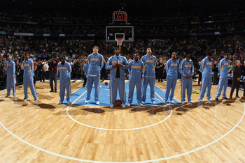 DENVER, CO - FEBRUARY 24:  The Denver Nuggets observe the national anthem prior to facing the Boston Celtics during NBA action at the Pepsi Center on February 24, 2011 in Denver, Colorado. The Nuggets defeated the Celtics 89-75. NOTE TO USER: User express