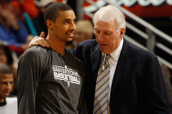 NEW ORLEANS, LA - JANUARY 22:  Head coach Greg Popovich talks with George Hill #3 of the San Antonio Spurs during the game against the New Orleans Hornets at the New Orleans Arena on January 22, 2011 in New Orleans, Louisiana.  NOTE TO USER: User expressl