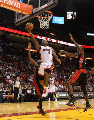 MIAMI, FL - JANUARY 22:  LeBron James #6 of the Miami Heat lays the ball in during a game against the Toronto Raptors at American Airlines Arena on January 22, 2011 in Miami, Florida. NOTE TO USER: User expressly acknowledges and agrees that, by downloadi