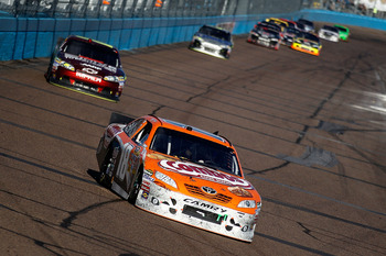 AVONDALE, AZ - FEBRUARY 27:  Kyle Busch, driver of the #18 Combos Toyota leads Jeff Gordon, driver of the #24  Drive to End Hunger Chevrolet near the end of the Subway Fresh Fit 500 at Phoenix International Raceway on February 27, 2011 in Avondale, Arizon