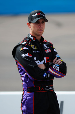 AVONDALE, AZ - FEBRUARY 26:  Denny Hamlin, driver of the #11 FedEx Toyota, stands on pit road during qualifying for the NASCAR Sprint Cup Series Subway Fresh Fit 500 at Phoenix International Raceway on February 26, 2011 in Avondale, Arizona.  (Photo by Ja