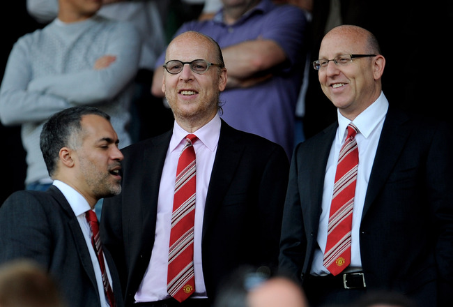 MANCHESTER, ENGLAND - APRIL 24:  Avram and Joel Glazer (R) look on prior to the Barclays Premier League match between Manchester United and Tottenham Hotspur at Old Trafford on April 24, 2010 in Manchester, England. (Photo by Michael Regan/Getty Images)