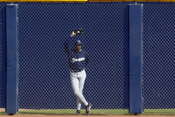 PEORIA, AZ - MARCH 4:  Luis Martinez #59 of the Milwaukee Brewers watches his team play the Seattle Mariners from the bullpen in a spring training game on March 4, 2003 at Peoria Sports Complex in Peoria, Arizona.   The Mariners defeated the Brewers 6-3.