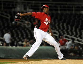 GOODYEAR, AZ - MARCH 03:  Aroldis Chapman #54 of the Cincinnati Reds delivers a pitch to the Los Angeles Dodgers at Goodyear Ballpark on March 3, 2011 in Goodyear, Arizona.  (Photo by Norm Hall/Getty Images)