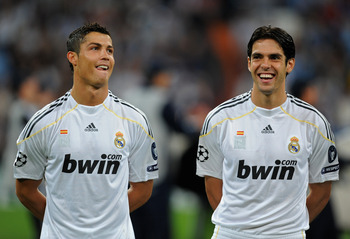MADRID, SPAIN - SEPTEMBER 30:  Cristiano Ronaldo (L) and Kaka of Real Madrid share a light moment prior to the Champions League group C match between Real Madrid and Marseille at the Estadio Santiago Bernabeu on September 30, 2009 in Madrid, Spain. Real M