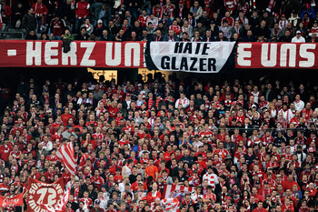 MUNICH, GERMANY - MARCH 30:  A sign displaying 'Hate Glazer' in among the Bayern fans during the UEFA Champions League quarter final first leg match between Bayern Muenchen and Manchester United at the Allianz Arena on March 30, 2010 in Munich, Germany.