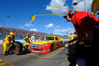 AVONDALE, AZ - FEBRUARY 27:  Kurt Busch, driver of the #22 Shell/Pennzoil Dodge, makes a pit stop during the NASCAR Sprint Cup Series Subway Fresh Fit 500 at Phoenix International Raceway on February 27, 2011 in Avondale, Arizona.  (Photo by Jared C. Tilt
