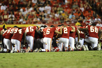 KANSAS CITY, MO - AUGUST 27: Players for the Kansas City Chiefs gather on the field to pray for Cameron Sheffield who suffered an injury during a preseason game against the Philadelphia Eagles at Arrowhead Stadium on August 27, 2010 in Kansas City, Missou