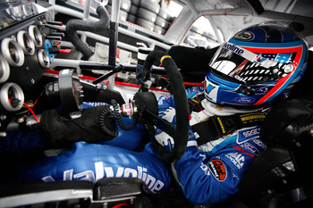 AVONDALE, AZ - FEBRUARY 25:  A.J. Allmendinger, driver of the #43 Valvoline Ford, sits in his car during practice for the Subway Fresh Fit 500 at Phoenix International Raceway on February 25, 2011 in Avondale, Arizona.  (Photo by Chris Graythen/Getty Imag