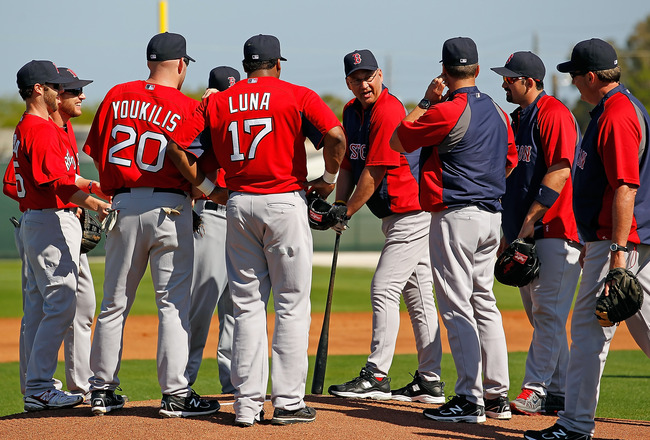 FORT MYERS, FL - FEBRUARY 19:  Manager Terry Francona #47 (leaning on a bat) of the Boston Red Sox talks with the infield during a Spring Training Workout Session at the Red Sox Player Development Complex on February 19, 2011 in Fort Myers, Florida.  (Pho