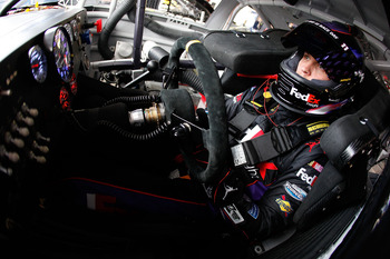 AVONDALE, AZ - FEBRUARY 25:  Denny Hamlin, driver of the #11 FedEx Toyota, sits in his car during practice for the Subway Fresh Fit 500 at Phoenix International Raceway on February 25, 2011 in Avondale, Arizona.  (Photo by Chris Graythen/Getty Images)
