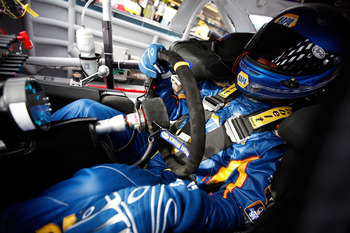 AVONDALE, AZ - FEBRUARY 25:  Martin Truex Jr., driver of the #56 NAPA Toyota, sits in his car during practice for the Subway Fresh Fit 500 at Phoenix International Raceway on February 25, 2011 in Avondale, Arizona.  (Photo by Chris Graythen/Getty Images)