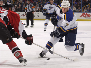 27 Nov 2001: Keith Tkachuk #7 of the St. Louis Blues takes a shot as Karel Rachunek #23 of the Ottawa Senators defends during the first period at the Savvis Center in St.Louis, Missouri. DIGITAL IMAGE. Mandatory Credit: Elsa/ALLSPORT