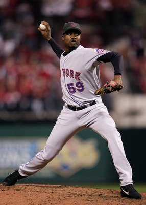 ST LOUIS, MO - OCTOBER 17:  Guillermo Mota #59 of the New York Mets pitches against the St. Louis Cardinals during game five of the NLCS at Busch Stadium on October 17, 2006 in St. Louis, Missouri.  (Photo by Elsa/Getty Images)