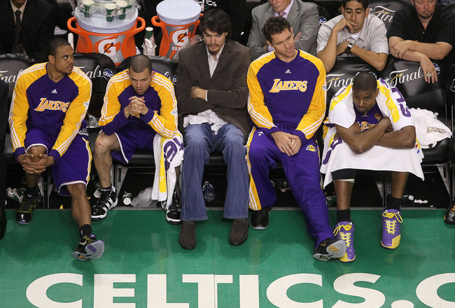 BOSTON - JUNE 10:  (L-R) Shannon Brown, Jordan Farmar, Adam Morrison, Luke Walton and Andrew Bynum of the Los Angeles Lakers look on dejected from the bench late in the fourth quarter against the Boston Celltics during Game Four of the 2010 NBA Finals on