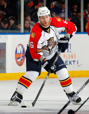 UNIONDALE, NY - FEBRUARY 21:  Dennis Wideman #6 of the Florida Panthers looks to pass during an NHL hockey game against the New York Islanders at the Nassau Coliseum on February 21, 2011 in Uniondale, New York.  (Photo by Paul Bereswill/Getty Images)