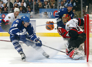TORONTO - APRIL 16:  Patrick Lalime #40 of the Ottawa Senators slides across the crease as Ron Francis #10 of the Toronto Maple Leafs misses on this scoring opportunity during game five of the Eastern Conference Quarter-Finals at the Air Canada Centre on