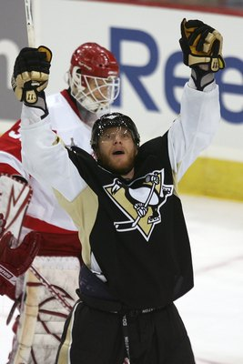PITTSBURGH - JUNE 04:  Marian Hossa #18 of the Pittsburgh Penguins celebrates after scoring a late third period goal against goaltender Chris Osgood #30 of the Detroit Red Wings during game six of the 2008 NHL Stanley Cup Finals at Mellon Arena on June 4,