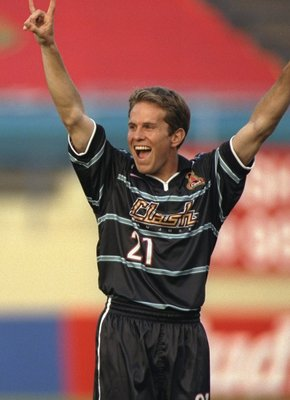 30 Apr 1999:  Eddie Lewis #21 of the San Jose Clash celebrates during the game against the Dallas Burn at the Spartan Stadium in San Jose, California. The Clash defeated the Burn 2-1. Mandatory Credit: Jed Jacobsohn  /Allsport