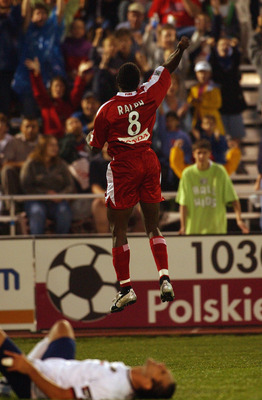 NAPERVILLE, IL - JUNE 18:  Damani Ralph #8 of the Chicago Fire celebrates during their MLS game on June 18, 2003 at Cardinal Stadium in Naperville, Illinois. The Fire defeated the Burn 4-1.  (Photo by Jonathan Daniel/Getty Images)