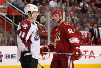 GLENDALE, AZ - MARCH 04:  Peter Mueller #88 of the Colorado Avalanche and Wojtek Wolski #86 of the Phoenix Coyotes await a face off during the first period of the NHL game at Jobing.com Arena on March 4, 2010 in Glendale, Arizona.  (Photo by Christian Pet