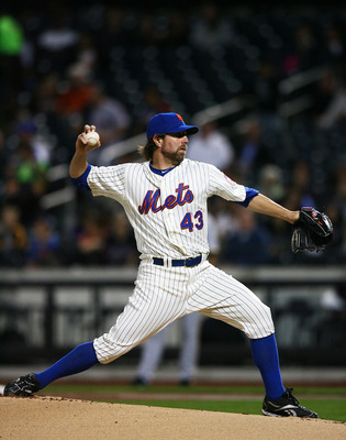 NEW YORK - SEPTEMBER 14:  R.A. Dickey #43 of the New York Mets pitches against the Pittsburgh Pirates on September 14, 2010 at Citi Field in the Flushing neighborhood of the Queens borough of New York City.  (Photo by Andrew Burton/Getty Images)