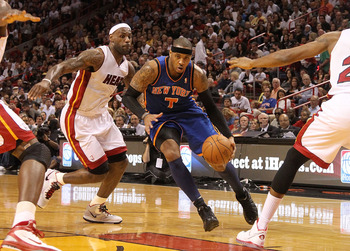 MIAMI, FL - FEBRUARY 27:  Carmelo Anthony #7 of the New York Knicks drives past LeBron James #6 of the Miami Heat during a game at American Airlines Arena on February 27, 2011 in Miami, Florida. NOTE TO USER: User expressly acknowledges and agrees that, b