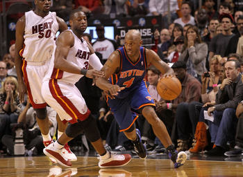 MIAMI, FL - FEBRUARY 27:  Chauncey Billups #4 of the New York Knicks drives past Dwyane Wade #3 of the Miami Heat during a game at American Airlines Arena on February 27, 2011 in Miami, Florida. NOTE TO USER: User expressly acknowledges and agrees that, b