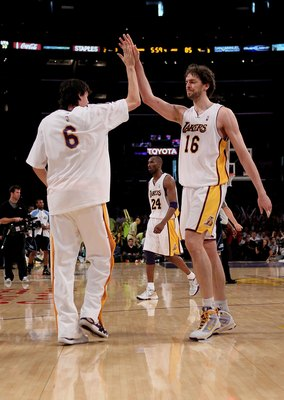 LOS ANGELES - MAY 2:  Pau Gasol #16 of the Los Angeles Lakers high fives with Adam Morrison #6 against the Utah Jazz during Game One of the Western Conference Semifinals of the 2010 NBA Playoffs on May2, 2010 at Staples Center in Los Angeles, California.