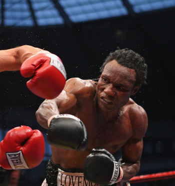MANCHESTER, UNITED KINGDOM - MAY 24:  Lovemore N'Dou hits Paulie Malignaggi with a right hand shot during the IBF light-welterweight championship fight between Paulie Malignaggi and Lovemore N'Dou at the City of Manchester Stadium on May 24, 2008 in Manch
