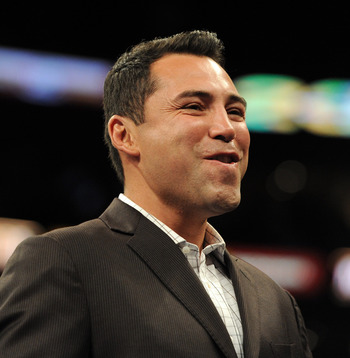 LOS ANGELES, CA - SEPTEMBER 18:  Oscar de la Hoya smiles before the Middleweight bout against Shane Mosley and Sergio Mora at Staples Center on September 18, 2010 in Los Angeles, California.  (Photo by Harry How/Getty Images)