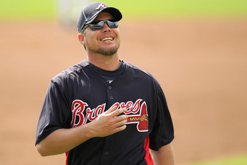 LAKE BUENA VISTA, FL - FEBRUARY 21:  Chipper Jones #10 of the Atlanta Braves stands on the field during a spring training workout at Champion Stadium on February 21, 2011 in Lake Buena Vista, Florida.  (Photo by Mike Ehrmann/Getty Images)