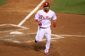 PHILADELPHIA - OCTOBER 17:  Shane Victorino #8 of the Philadelphia Phillies scores on a sacrifice fly by Placido Polanco #27 in the fifth inning against the San Francisco Giants in Game Two of the NLCS during the 2010 MLB Playoffs at Citizens Bank Park on