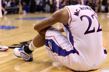 OKLAHOMA CITY - MARCH 20:  Marcus Morris #22 of the Kansas Jayhawks remains on the court dejected after they lost 69-67 against the Northern Iowa Panthers during the second round of the 2010 NCAA men's basketball tournament at Ford Center on March 20, 201