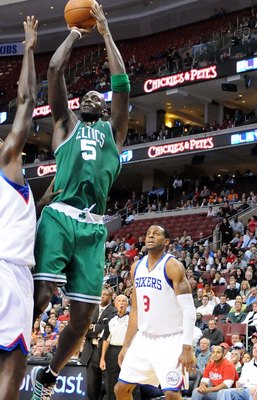 PHILADELPHIA - NOVEMBER 03:  Kevin Garnett #5 of the Boston Celtics attempts a shot against Samuel Dalembert #1 and Andre Iguodala #9 of the Philadelphia 76ers at the Wachovia Center on November 3, 2009 in Philadelphia, Pennsylvania.  NOTE TO USER: User e