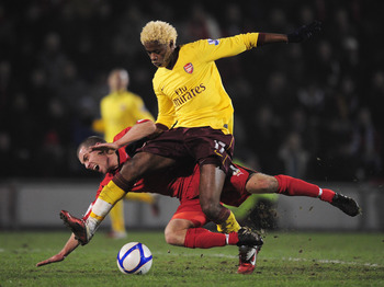 LONDON, ENGLAND - FEBRUARY 20:   Alex Song of Arsenal challenges Stephen Dawson of Leyton Orient during the FA Cup sponsored by E.ON 5th Round match between Leyton Orient and Arsenal at the Matchroom Stadium on February 20, 2011 in London, England.  (Phot