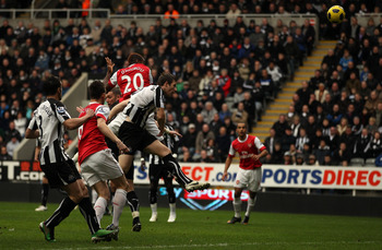NEWCASTLE UPON TYNE, ENGLAND - FEBRUARY 05:  Johan Djourou of Arsenal scores the second goal during the Barclays Premier League match between Newcastle United and Arsenal at St James' Park on February 5, 2011 in Newcastle upon Tyne, England.  (Photo by Ri
