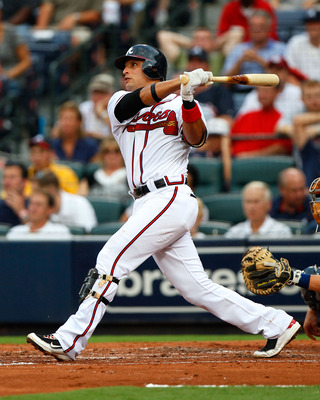 ATLANTA - JULY 15:  Martin Prado #14 of the Atlanta Braves hits a solo homer in the third inning against the Milwaukee Brewers at Turner Field on July 15, 2010 in Atlanta, Georgia.  (Photo by Kevin C. Cox/Getty Images)
