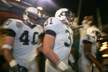MIAMI GARDENS, FL - JANUARY 3:  Paul Posluszny #31 and Dan Connor #40 of the Penn State Nittany Lions walk out of the tunnel during the FedEx Orange Bowl against the Florida State Seminoles at Dolphins Stadium on January 3, 2005 in Miami Gardens, Florida.