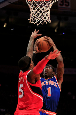 NEW YORK, NY - FEBRUARY 16:  Amar'e Stoudemire #1 of the New York Knicks shoots the ball over Josh Smith #5 of the Atlanta Hawks at Madison Square Garden on February 16, 2011 in New York City. NOTE TO USER: User expressly acknowledges and agrees that, by