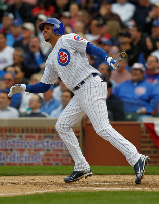 CHICAGO - APRIL 12: Aramis Ramirez #16 of the Chicago Cubs follows the flight of his fourth inning home run against the Milwaukee Brewers on Opening Day at Wrigley Field on April 12, 2010 in Chicago, Illinois. (Photo by Jonathan Daniel/Getty Images)