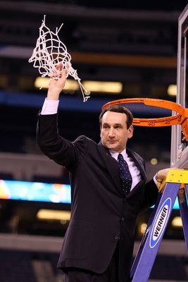 INDIANAPOLIS - APRIL 05:  Head coach Mike Krzyzewski of the Duke Blue Devils celebrates after he cut down a piece of the net following their 61-59 win against the Butler Bulldogs during the 2010 NCAA Division I Men's Basketball National Championship game