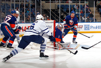 UNIONDALE, NY - FEBRUARY 08:  Mikko Koskinen #1 of the New York Islanders makes a save against Clarke MacArthur #16 of the Toronto Maple Leafs on February 8, 2011 at Nassau Colsium in Uniondale, New York.  (Photo by Lou Capozzola/Getty Images)