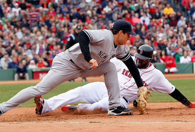 BOSTON - OCTOBER 3:  Mark Teixeira #25 of the New York Yankees executes the second out of a double play on base runner David Ortiz #34 of  the Boston Red Sox, who was caught off of first base, at Fenway Park, October 3, 2010, in Boston, Massachusetts. (Ph