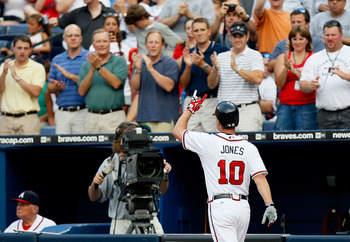 ATLANTA - JULY 15:  Chipper Jones #10 of the Atlanta Braves reacts after hitting a solo homer in the third inning against the Milwaukee Brewers at Turner Field on July 15, 2010 in Atlanta, Georgia.  (Photo by Kevin C. Cox/Getty Images)