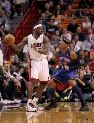 MIAMI, FL - FEBRUARY 27:  LeBron James #6 of the Miami Heat is guarded by Carmelo Anthony #7 of the New York Knicks during a game at American Airlines Arena on February 27, 2011 in Miami, Florida. NOTE TO USER: User expressly acknowledges and agrees that,