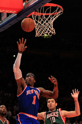 NEW YORK, NY - FEBRUARY 23:  Amare Stoudemire #1 of the New York Knicks shoots the ball over Carlos Delfino #10 of the Milwaukee Bucks at Madison Square Garden on February 23, 2011 in New York City. NOTE TO USER: User expressly acknowledges and agrees tha
