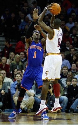 CLEVELAND, OH  - FEBRUARY 25:  Christian Eyenga #8 of the Cleveland Cavaliers puts up a shot in front of Amar'e Stoudemire #1 of the New York Knicks during the game on February 25, 2011 at Quicken Loans Arena in Cleveland, Ohio. NOTE TO USER: User express