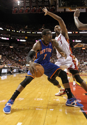 MIAMI, FL - FEBRUARY 27:  Amar'e Stoudemire #1 of the New York Knicks posts up Chris Bosh #1 of the Miami Heat during a game at American Airlines Arena on February 27, 2011 in Miami, Florida. NOTE TO USER: User expressly acknowledges and agrees that, by d